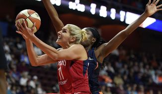 Washington Mystics forward Elena Delle Donne (11) goes by Connecticut Sun forward Chiney Ogwumike for a basket during the first half of a WNBA basketball game Wednesday, June 13, 2018, in Uncasville, Conn.. (Sean D. Elliot/The Day via AP) **FILE**