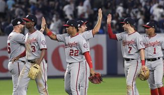 Washington Nationals' Matt Adams (15), Michael Taylor (3), Juan Soto (22), Anthony Rendon, Trea Turner (7) and Wilmer Difo (1) celebrate after the Nationals defeated the New York Yankees 5-4 in a baseball game Wednesday, June 13, 2018, at Yankee Stadium in New York. (AP Photo/Bill Kostroun) **fiLE**