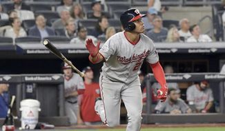 Washington Nationals' Juan Soto tosses his bat after hitting a home run against the New York Yankees during the seventh inning of a baseball game Wednesday, June 13, 2018, at Yankee Stadium in New York. (AP Photo/Bill Kostroun)