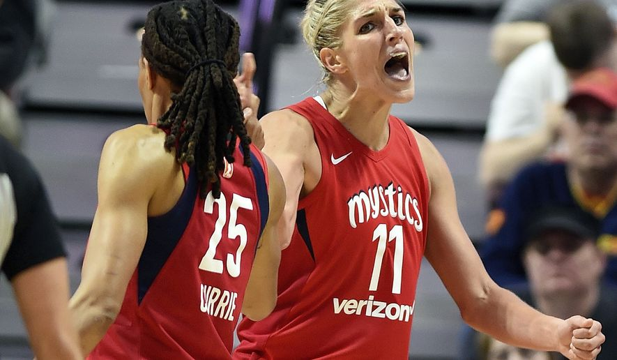 Washington Mystics forward Elena Delle Donne (11) celebrates with teammate Monique Currie (25) earlier this season (File photo, Sean D. Elliot/The Day via AP)