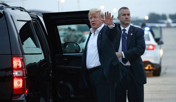 U.S. President Donald Trump yells to reporters after arriving at Andrews Air Force Base after a summit with North Korean leader Kim Jong-un in Singapore, Wednesday, June 13, 2018, in Andrews Air Force Base, Md. (AP Photo/Evan Vucci)