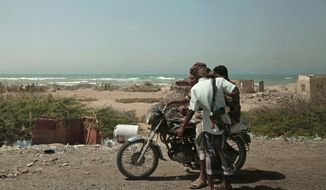 FILE - In this Feb. 12, 2018 file photo, Saudi-backed forces, part of Ahmed al-Kawkabani's, southern resistance unit in Hodeida, patrol in Hodeida, Yemen. The Saudi-led coalition backing Yemen's exiled government began an assault Wednesday, June 13, 2018 on the port city of Hodeida, the main entry point for food in a country already teetering on the brink of famine.(AP Photo/Nariman El-Mofty, File) **FILE**