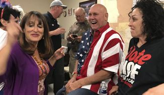 """ADDS IDENITY OF WOMAN AT RIGHT AS HEIDI FLEISS -  In this Tuesday, June 12, 2018 photo Nevada brothel owner Dennis Hof, second from right celebrates after winning the primary election in Pahrump, Nev. Hof, the owner of half a dozen legal brothels in Nevada and star of the HBO adult reality series """"Cathouse,"""" won a Republican primary for the state Legislature on Tuesday, ousting a three-term lawmaker. At right is former madam and reality TV personality Heidi Fleiss.  (David Montero /Los Angeles Times via AP)"""