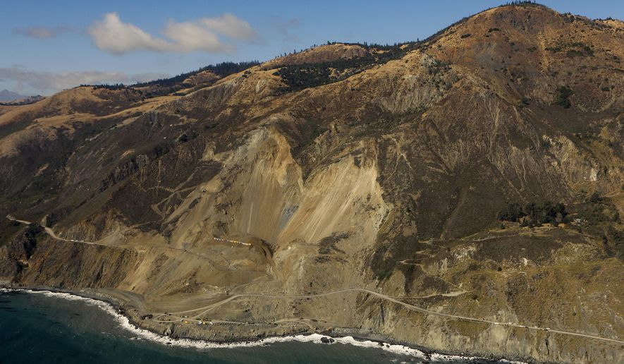 FILE - In this Sept. 15, 2017, file photo, work continues at the Mud Creek slide, on the Big Sur Coast of Calif. California transportation officials are targeting July for reopening a stretch of iconic Highway 1 in the scenic Big Sur coastal region that was blocked last year by a massive landslide. The crucial road that connects Los Angeles to San Francisco was projected to open in mid-September but Caltrans announced Tuesday, June 12, 2018, it will open to all travelers by the end of July.(Joe Johnston/The Tribune (of San Luis Obispo) via AP, File)