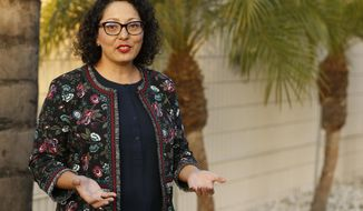 FILE - In this April 27, 2018, file photo California Assemblywoman Cristina Garcia, D-Bell Gardens, poses for a picture at her campaign headquarters in Downey, Calif. The California Legislature is resuming an investigation into allegations of misconduct by Garcia in light of concerns raised about the initial investigation into her conduct. Garcia was accused of groping a former legislative staffer. The Los Angeles area Democrat denies the allegation and independent investigators didn't find evidence to support it. However investigators did find Garcia used vulgar language in violation of the Assembly's sexual harassment policy. (AP Photo/Damian Dovarganes, File)