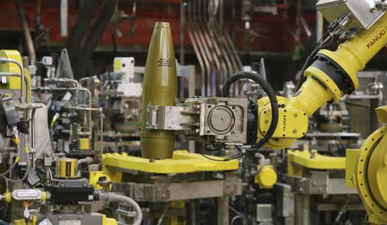 FILE - In this Jan. 29, 2015, file photo, a remotely controlled robot handles an inert simulated chemical munition during training at the Pueblo Chemical Depot in southern Colorado. The Army announced Wednesday, June 13, 2018, the depot had resumed destroying decades-old shells containing liquid mustard agent this week. The plant had been shut down for repairs since September. (AP Photo/Brennan Linsley, File)