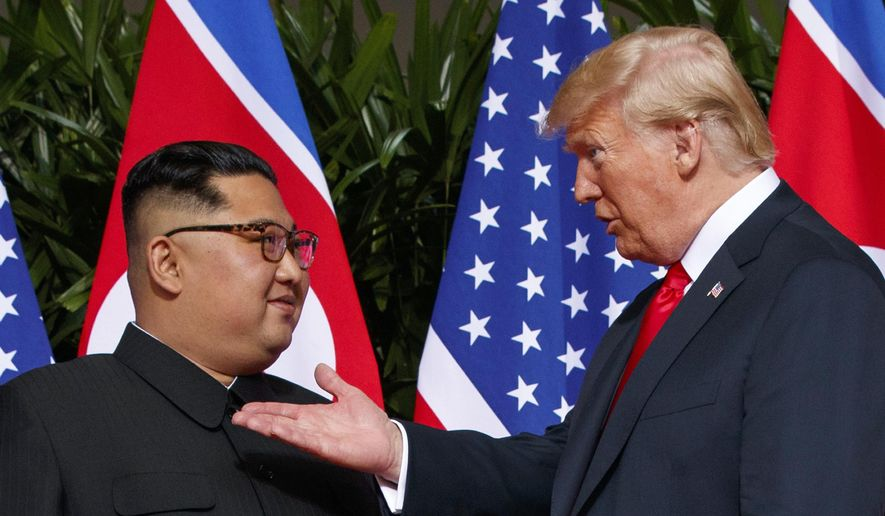 In this June 12, 2018, file photo, U.S. President Donald Trump, right, meets with North Korean leader Kim Jong-un on Sentosa Island in Singapore. (AP Photo/Evan Vucci, File)