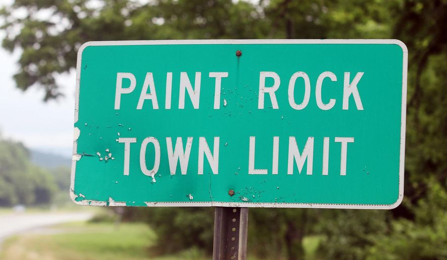 A city limit sign for the town of Paint Rock, Ala., is pictured on Wednesday, June 13, 2018. The mayor of the city of 200 people is backing down from an attempt to bar the media and out-of-towners from attending council meetings. (Brandon Cox/The Daily Sentinel via AP)