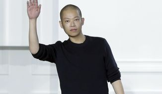 FILE - In this Feb. 13, 2015 file photo, designer Jason Wu acknowledges audience applause after his Fall 2015 collection was modeled during Fashion Week, in New York. The packaging for his namesake eau de parfum was nominated for a Fragrance Foundation Award. (AP Photo/Richard Drew, File)