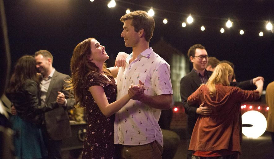 """This image released by Netflix shows Zoey Deutch, left, and Glen Powell in a scene from """"Set It Up,"""" premiering June 15 on Netflix. (KC Baily/Netflix via AP)"""