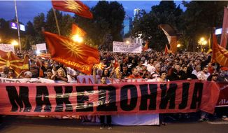 People demonstrate against the change of the country's constitutional name in front of the Parliament building in Skopje, Macedonia, Wednesday, June 13, 2018. A historic deal ending a decades-long dispute between neighbors Greece and Macedonia over the latter's name met with mixed reactions in both countries Wednesday, with some welcoming the agreement and others horrified at what they see as unacceptable concessions. (AP Photo/Boris Grdanoski)