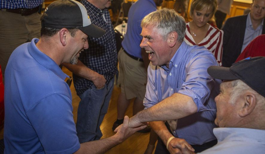 Maine Republican gubernatorial primary candidate Shawn Moody is congratulated by supporters  in Gorham, Maine Tuesday,  June 12, 2018.  Moody won Tuesday's ranked-choice voting primary in the race to succeed Maine's firebrand Gov. Paul LePage, while no clear majority winner had emerged in the Democratic primary.  (Troy R. Bennett/The Bangor Daily News via AP)