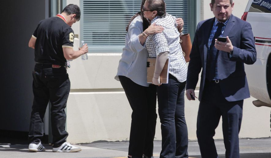 Members of the Salgado family hug after exiting the North Annex building at the Utah County Sheriff's Office on Wednesday, June 13, 2018, in Spanish Fork, Utah. The family of a Mexican woman found dead in Provo are in Utah to meet with and pressure investigators to solve the case. The 26-year-old Elizabeth Elena Laguna Salgado, of Chiapas, Mexico, who was missing since April 16, 2015, was found in Hobble Creek Canyon. (Evan Cobb/The Daily Herald via AP)