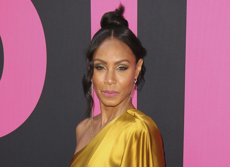 """In this July 13, 2017, file photo, Jada Pinkett Smith arrives at the world premiere of """"Girls Trip"""" in Los Angeles. Pinkett Smith hosts a multi-generational Facebook show Red Table Talk. (Photo by Willy Sanjuan/Invision/AP, File)"""