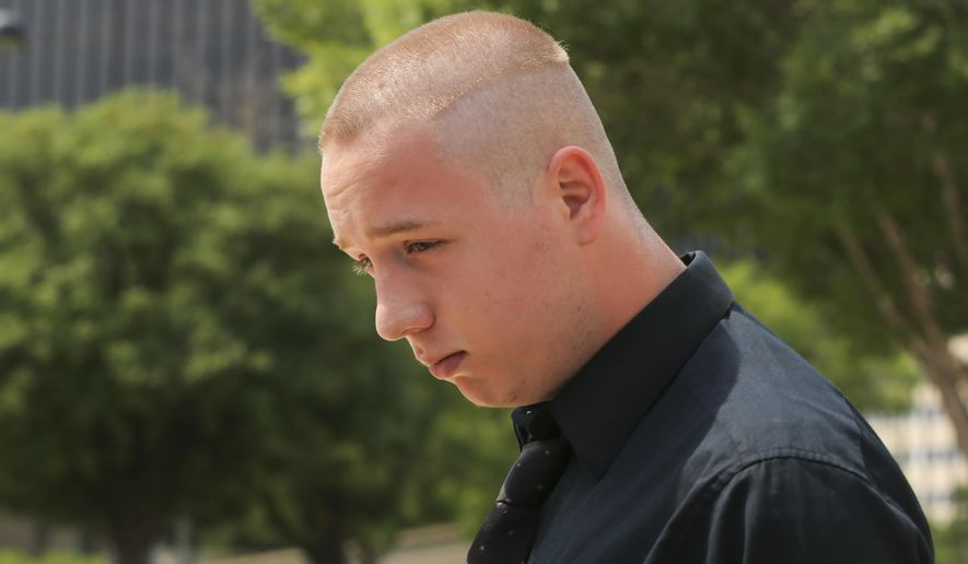 """Shane Gaskill, 19, of Wichita, Kan., leaves the federal court in Wichita, Wednesday, June 13, 2018. Gaskill and Casey Viner, 18, of North College Hill, Ohio, online gamers whose alleged dispute over a $1.50 Call of Duty WWII video game bet ultimately led police to fatally shoot a Kansas man, pleaded not guilty Wednesday to charges related to the """"swatting"""" case that drew national attention. (Jaime Green/The Wichita Eagle via AP)"""