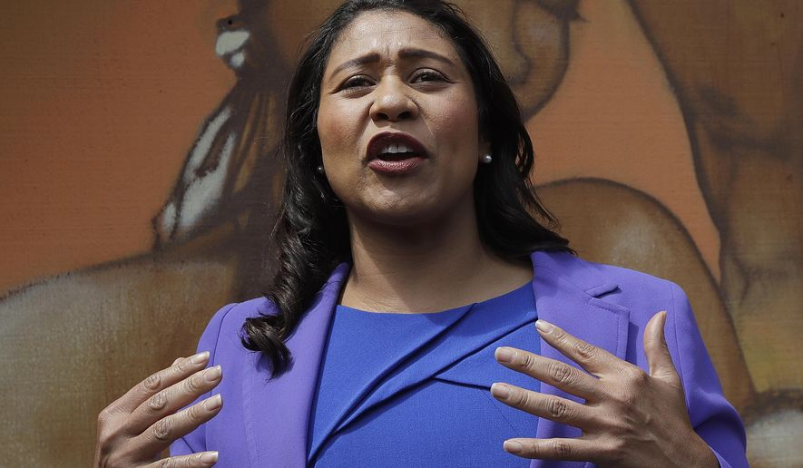 FILE - In this June 6, 2018 file photo, mayoral candidate and Board of Supervisors President London Breed speaks to reporters in San Francisco. Breed was poised to become the first African-American woman to lead San Francisco following a hard-fought campaign when a former state senator conceded and congratulated her Wednesday,  June 13, more than a week after the election. (AP Photo/Jeff Chiu, File)