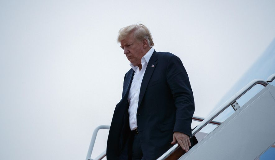 U.S. President Donald Trump arrives at Andrews Air Force Base after a summit with North Korean leader Kim Jong Un in Singapore, Wednesday, June 13, 2018, in Andrews Air Force Base, Me. (AP Photo/Evan Vucci)
