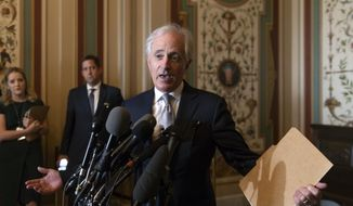 Senate Foreign Relations Committee Chairman Bob Corker, R-Tenn., speaks to reporters after meeting with Canada's Minister of Foreign Affairs Chrystia Freeland on Capitol Hill in Washington, Wednesday, June 13, 2018. (AP Photo/J. Scott Applewhite) ** FILE **
