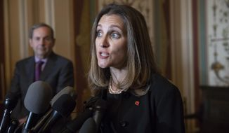 "Canadian Minister of Foreign Affairs Chrystia Freeland speaks with reporters after meeting with the U.S. Senate Foreign Relations Committee at the Capitol in Washington, Wednesday, June 13, 2018. Freeland's visit comes after President Donald Trump insulted Canadian Prime Minister Justin Trudeau at the recent Group of Seven summit in Canada, calling him ""dishonest"" and ""weak,"" after the prime minister spoke against American tariffs on steel and aluminum. (AP Photo/J. Scott Applewhite)"