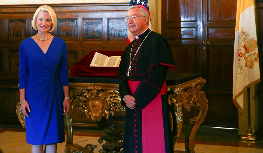 """U.S. Ambassador Callista Gingrich presented a third letter Thursday to Archbishop Jean-Louis Brugues, chief Vatican archivist. U.S. investigators were thanked for their """"keen eye and fine detective work."""" (Associated Press)"""