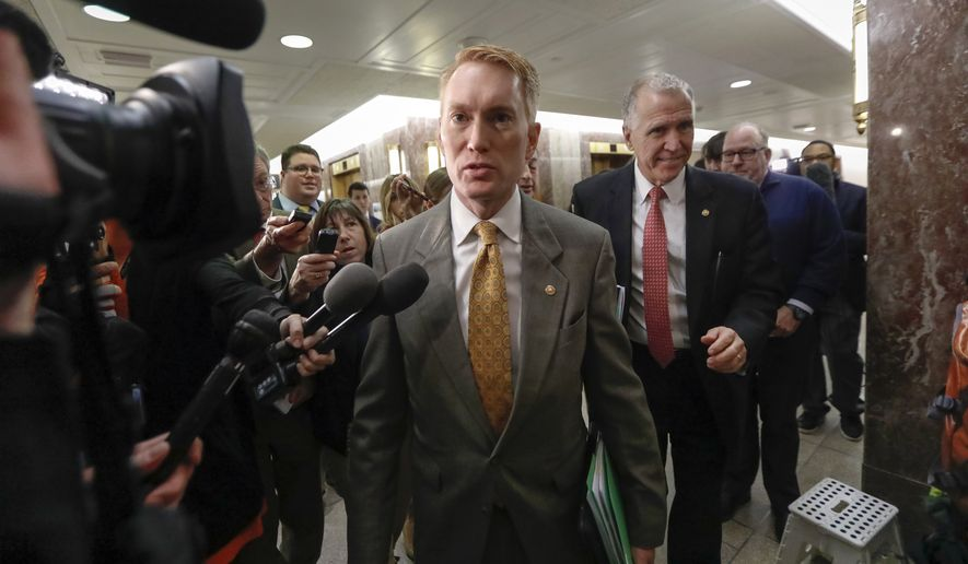 """Sen. James Lankford, Oklahoma Republican, posted a video of himself talking to a constituent and saying that while separation happens any time a parent is sent to jail, it should be rare in immigration cases. """"Keep families together as much as we can possible keep families together for as long as we can,"""" he said. (Associated Press)"""