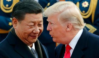 In this Nov. 9, 2017, file photo, U.S. President Donald Trump, right, chats with Chinese President Xi Jinping during a welcome ceremony at the Great Hall of the People in Beijing. The Trump administration has once again declined to brand China a currency manipulator, but it did target that country and five others for special monitoring for what the administration says are practices that are worsening America's trade deficit. (AP Photo/Andy Wong, File)