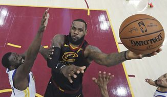 6. LeBron James: $85.5 million (Basketball, U.S.)  Cleveland Cavaliers' LeBron James shoots against Golden State Warriors' Draymond Green during the first half of Game 3 of basketball's NBA Finals, Wednesday, June 6, 2018, in Cleveland. (Gregory Shamus/Pool Photo via AP)