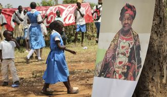 A poster of Sarah Obama, the step-grandmother of President Barack Obama, is displayed during a groundbreaking ceremony for her Mama Sarah Obama Foundation charitable organization, in her home town of Kogelo, near Kisumu, in Kenya Saturday, July 18, 2015. President Barack Obama is due to make his first trip as president to Kenya later in the month, the country of his father's birth, to attend the Global Entrepreneurship Summit, which brings together business leaders, international organizations and governments. (AP Photo)