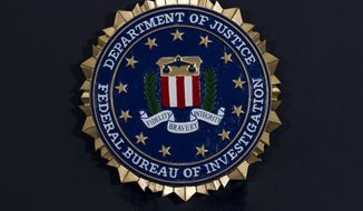 The FBI seal is seen before FBI Director Christopher Wray news conference on the inspector general's report at FBI headquarters on Thursday, June 14, 2018, in Washington. (AP Photo/Jose Luis Magana)