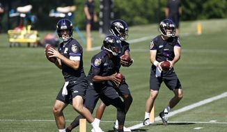 Baltimore Ravens quarterbacks Joe Flacco, from left, Robert Griffin III, Lamar Jackson and Josh Woodrum run a drill during an NFL football practice at the team's headquarters in Owings Mills, Md., Thursday, June 14, 2018. (AP Photo/Patrick Semansky)