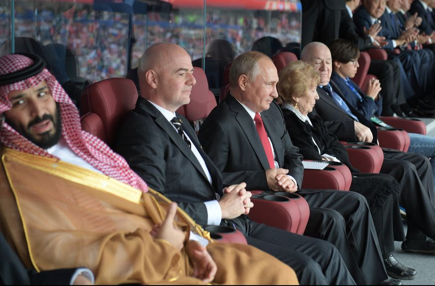 From left, Saudi Arabia Crown Prince Mohammed bin Salman, FIFA President Gianni Infantino, and Russian President Vladimir Putin watch the match between Russia and Saudi Arabia which opens the 2018 soccer World Cup at the Luzhniki stadium in Moscow, Russia, Thursday, June 14, 2018. (Alexei Druzhinin, Sputnik, Kremlin Pool Photo via AP)