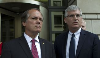 James Wolfe, left, former director of security with the Senate Intelligence Committee, is accompanied by his attorney Benjamin Klubes as they leave the federal courthouse, Wednesday, June 13, 2018, in Washington. (AP Photo/Jose Luis Magana)