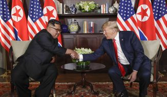 In this Tuesday, June 12, 2018, file photo, North Korea leader Kim Jong-un, left, and U.S. President Donald Trump shake hands during their first meeting at the Capella resort on Sentosa Island in Singapore. (AP Photo/Evan Vucci, File)