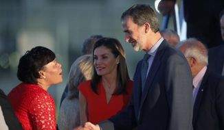 New Orleans Mayor LaToya Cantrell, left, greets King Felipe VI and Queen Letizia of Spain as they arrive at Louis Armstrong New Orleans International Airport in New Orleans, Thursday, June 14, 2018. The King and Queen are in New Orleans to help celebrate the city's 300th anniversary, which was colonized by Spain from 1763 to 1802. (AP Photo/Gerald Herbert)