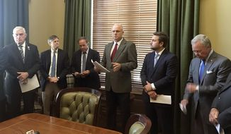 Arkansas state Sen. Jim Hendren, center, the incoming Senate president, talks to reporters at the state Capitol in Little Rock, Ark., on Thursday, June 14, 2018, about proposed changes to ethics rules that will go before the chamber. (AP Photo/Andrew DeMillo)