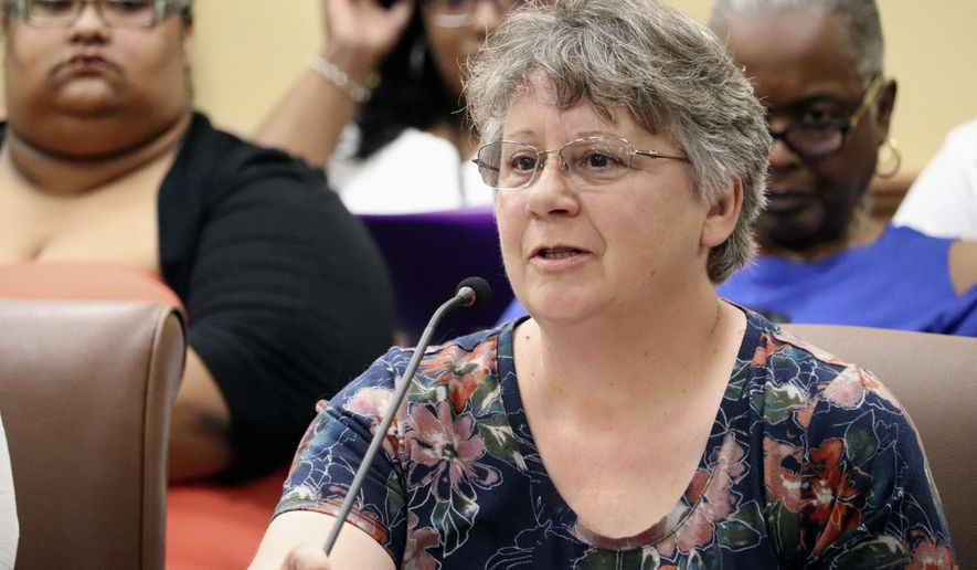 Debbie Holt, of Centerton, Ark., tells the prisons subcommittee of the Arkansas Legislative Council in Little Rock on Thursday, June 14, 2018, that two incarcerated sons have received poor medical care behind bars. After hearing similar complaints from others, Correction Department officials said there is room for improvement but that, at times, inmates don't tell the truth. (AP Photo/Kelly P. Kissel)