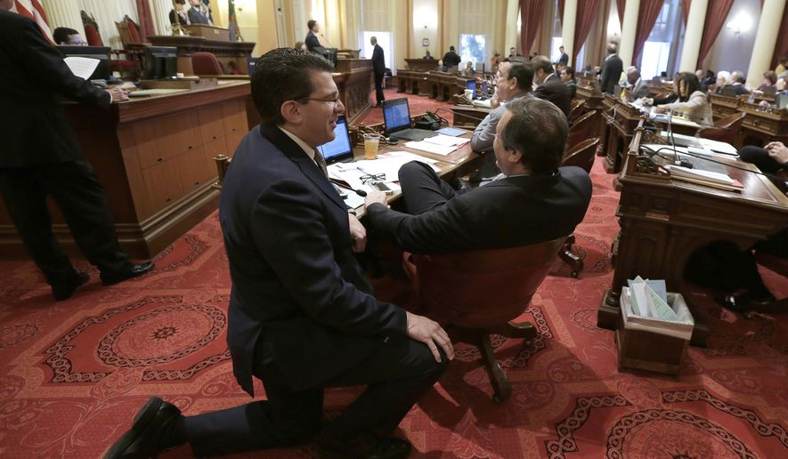 Assemblyman Jay Obernolte, R-Beg Bear Lake, left, visits with Sen.Scott Wilk, , R-Santa Clarita, at the Capitol Thursday, June 14, 2018, in Sacramento, Calif. Lawmakers are expected to vote on a $139 billion state budget planThursday. (AP Photo/Rich Pedroncelli)