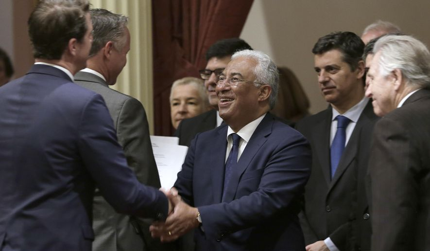 Antonio Costa, center, the prime minister of Portugal, is greeted by Sen. Henry Stern, D-Canoga Park, left, during his appearance at the Capitol, Thursday, June 14, 2018, in Sacramento, Calif. Costa and other officials visited the Senate to boost ties between the two governments. (AP Photo/Rich Pedroncelli)