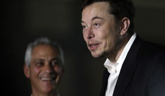 Chicago Mayor Rahm Emanuel, left, listens as Tesla CEO and founder of the Boring Company Elon Musk, right, speaks at a news conference Thursday, June 14, 2018, in Chicago. The Boring Company has been selected to build a high-speed underground transportation system that it says will whisk passengers from downtown Chicago to O'Hare International Airport in mere minutes. (AP Photo/Kiichiro Sato)