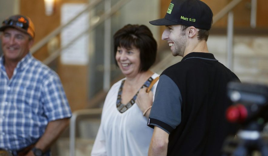 Bradie Gray laughs with his parents Mick and Sharon on Wednesday, June 13, 2018, at Wyoming Medical Center in Casper, Wyoming. The Australian bull rider suffered massive internal injuries when he was stepped on by a bull during the 2017 College National Finals Rodeo in Casper. Doctors initially gave him a 40 percent chance of survival, but he walked out of the hospital three weeks later. (Alan Rogers, Casper Star-Tribune via AP)