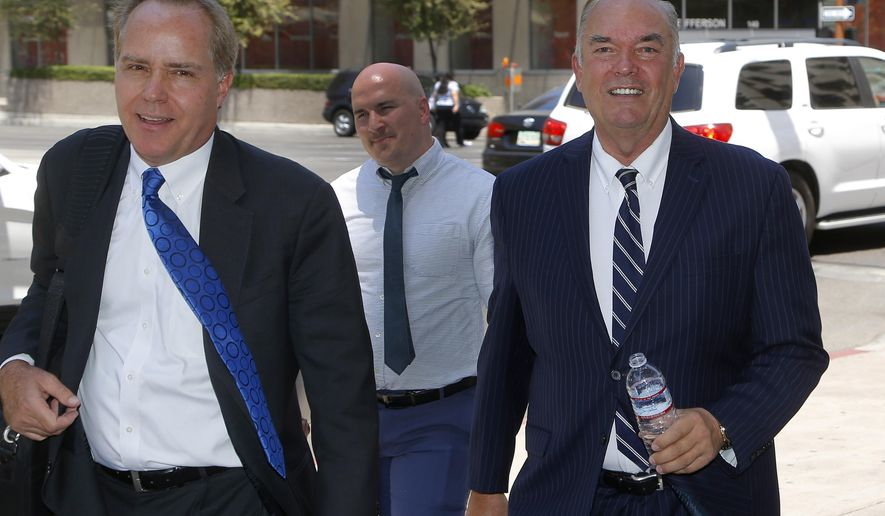 Expelled Arizona House Rep. Don Shooter, right, arrives at court with attorney Tim Nelson, left, Thursday, June 14, 2018, in Phoenix. A Maricopa County judge says she'll decide tomorrow whether the former Yuma lawmaker, Shooter, expelled from the state House of Representatives after sexual harassment allegations can run for state Senate. Another Republican candidate, Brent Backus, filed a lawsuit saying Shooter couldn't run because he lives in Phoenix, not Yuma.  (AP Photo/Ross D. Franklin)