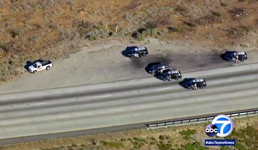 This still image taken from video provided by KABC-TV shows the end of a pursuit of a man in a pickup truck on the northbound Interstate 15 freeway in the Cajon Pass near San Bernardino, Calif., Wednesday afternoon, June 13, 2018. The driver who led authorities on a 90-minute freeway chase in Southern California apparently has shot himself. (KABC-TV via AP)