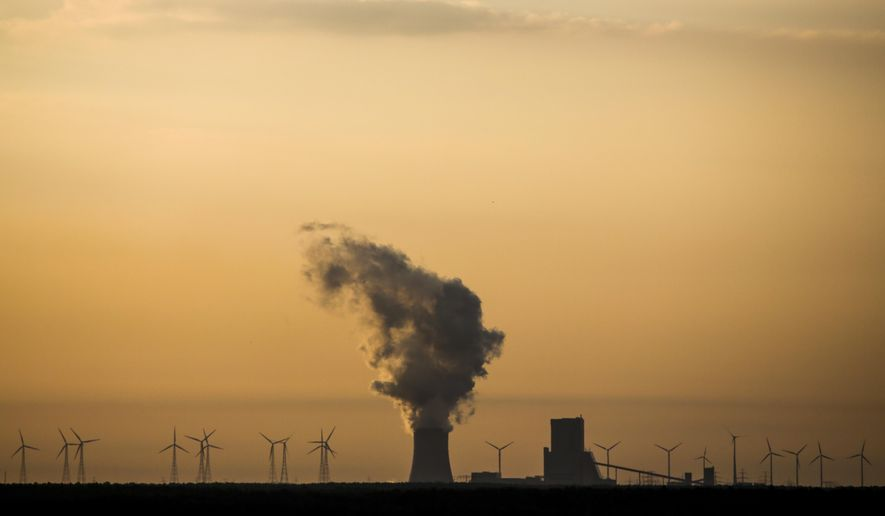 In this Tuesday, June 5, 2018, photo, steam rises in the air from the brown coal power plant Schwarze Pumpe in the Lusatia, (Lausitz) area in Germany. (AP Photo/Markus Schreiber)
