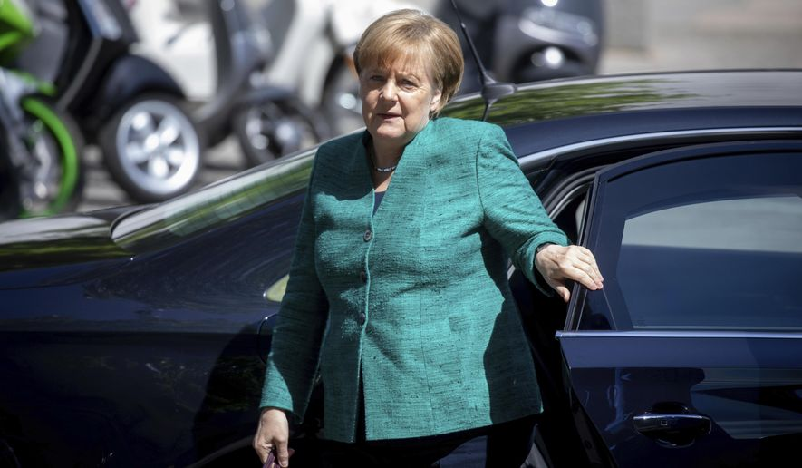 German Chancellor Angela Merkel arrives for a special meeting of her Cristian Union faction at the Reichstags building, in Berlin Thursday, June 14, 2018.  Kay Nietfeld/dpa via AP)