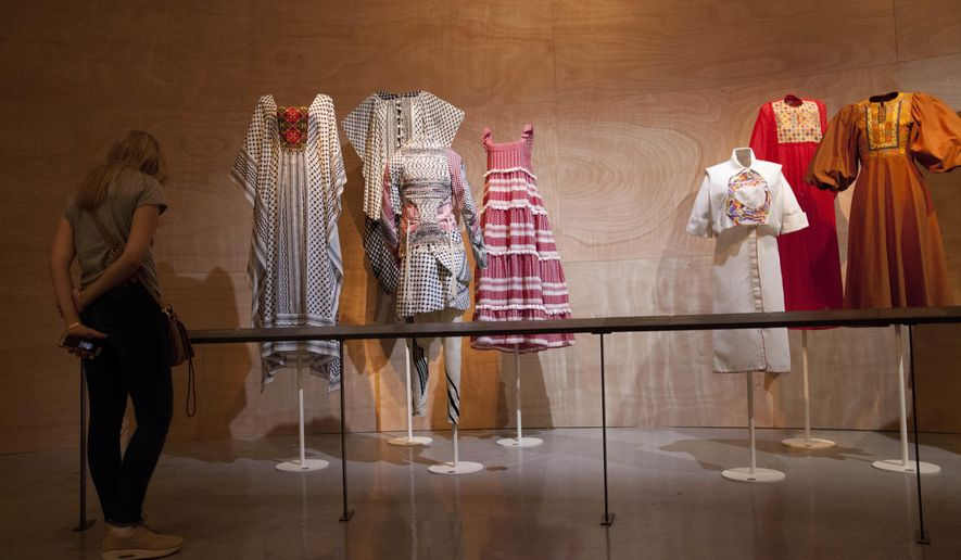 "A woman looks at ""Fashion Statements: Decoding Israeli Dress"" exhibition at Israel Museum in Jerusalem, Thursday, June 14, 2018. (AP Photo/Caron Creighton)"