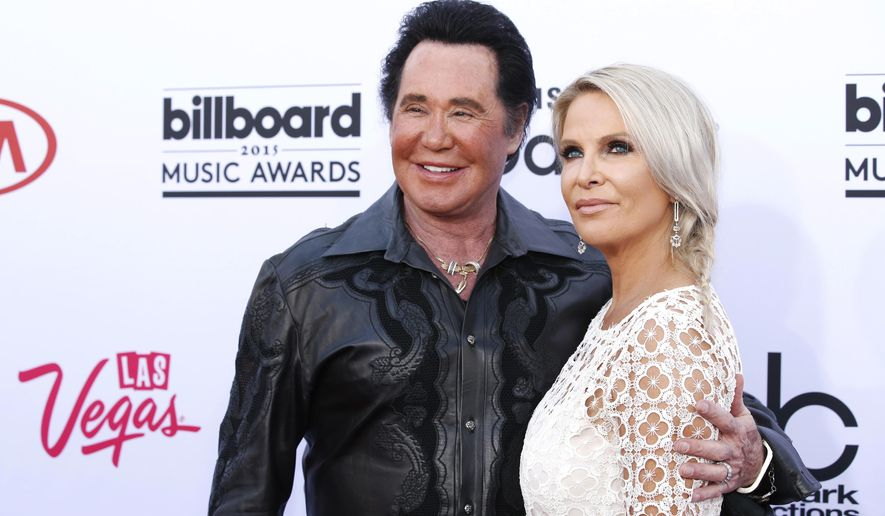 File - In this May 17, 2015 file photo, Wayne Newton, left, and his wife Kathleen McCrone arrive at the Billboard Music Awards at the MGM Grand Garden Arena in Las Vegas. Police are looking for two suspected burglars who eluded officers overnight after a break-in at the estate of longtime Las Vegas entertainer Wayne Newton. Officer Jacinto Rivera said Thursday, June 14, 2018, that Las Vegas police responded to a burglary call Wednesday at Newton's home several miles southeast of the Las Vegas Strip. (Photo by Eric Jamison/Invision/AP, File)