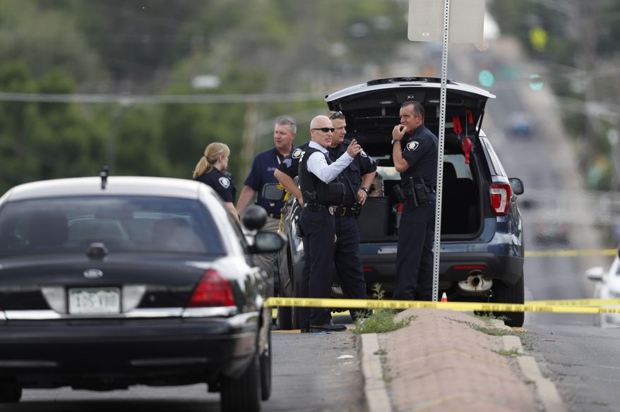 Law enforcement officials investigate around the scene of a shooting in a parking lot behind a dentist's office, Thursday, June 14, 2018, in Westminster, Colo. (AP Photo/David Zalubowski)