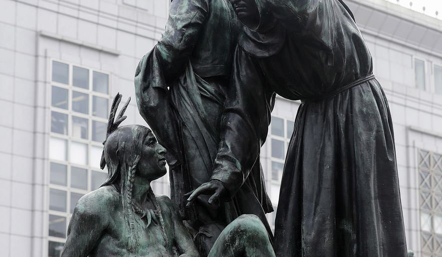 """FILE - This March 2, 2018 file photo shows a statue that depicts a Native American at the feet of a Spanish cowboy and Catholic missionary in San Francisco. Activists urging the removal of the prominent 19th century statue will get another chance to make their case. The San Francisco Chronicle reports the city's Board of Appeals voted Wednesday, June 13 to grant a rehearing on removing the """"Early Days"""" statue near City Hall. (AP Photo/Jeff Chiu, File)"""