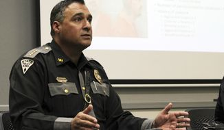 """FILE - In this Sept. 15, 2017, file photo, New Mexico State Police officer Pete Kassetas is shown during a news conference in Albuquerque, N.M. Kassetas has been accused of discrimination, lewd behavior and """"malice"""" toward women in a lawsuit filed Tuesday, June 12, 2018, by a sergeant in his department and two former employees. (AP Photo/Susan Montoya Bryan, file)"""
