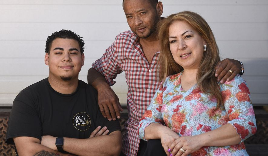 Stamford, Conn., resident Nelson Rosales Santos, center, poses with his wife, Patricia Morales, and son, Christian, outside Building One Community in Stamford, Conn. Thursday, June 14, 2018. Federal immigration officials granted a six-month reprieve Thursday to Nelson Rosales Santos, a Connecticut immigrant facing deportation, a move that may allow him to undergo a scheduled kidney transplant. (Tyler Sizemore/Hearst Connecticut Media via AP)